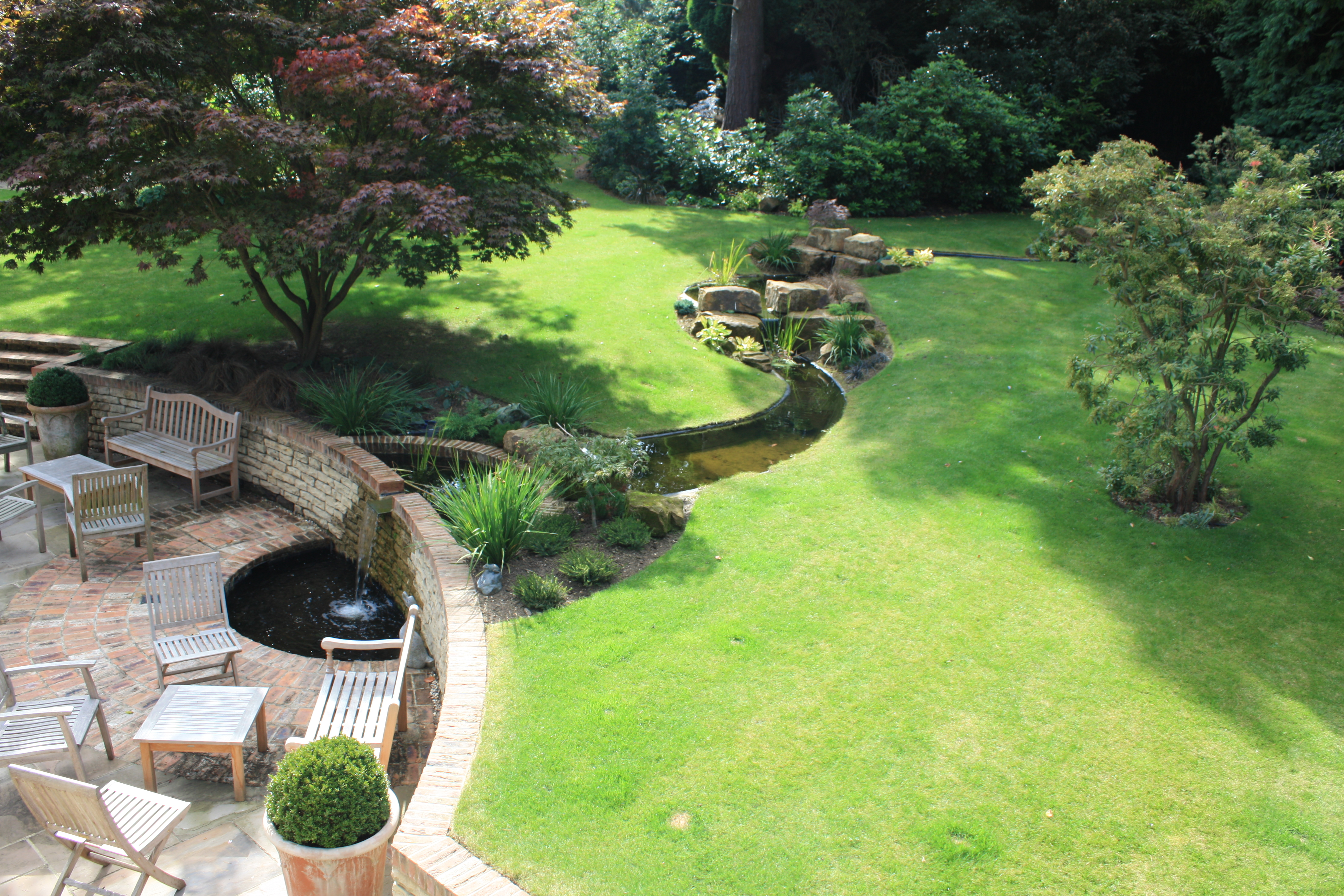 A large award nominated garden with water feature near for Garden design georgian house